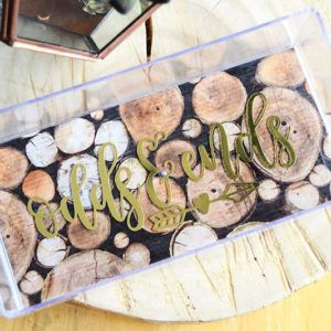 Turn a dollar store store find into a trendy acrylic catchall tray with the help of Mod Podge! This organizing project is perfect for beginners.