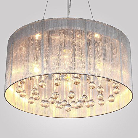 Living room decor always need a luxurious suspension lamp. Discover more luxurious interior design details at luxxu.net