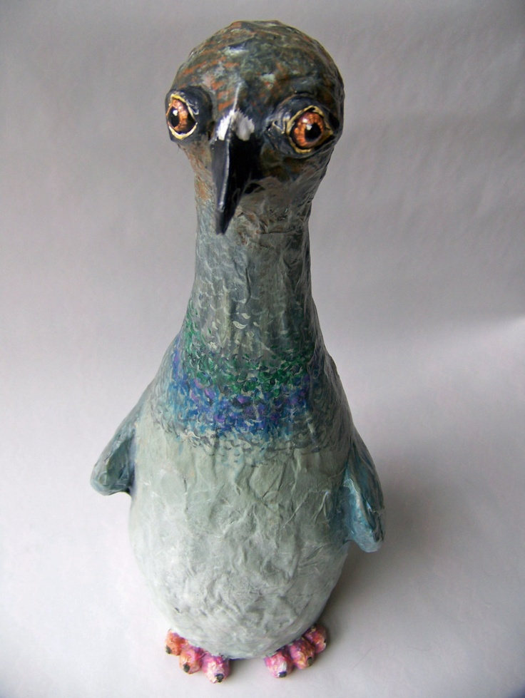 Pigeon sculpture made from champaign bottle and paper