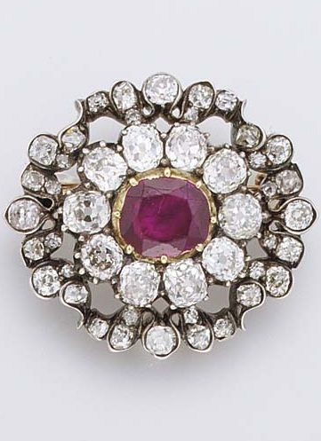 c1860 Ruby and Diamond Brooch w the central cushion-shaped ruby and old-cut diamond cluster to the diamond openwork surround, mounted in silver and gold, 2.8 cm wide, reverse engraved 'Vente des diamants de la Couronne Mai 1887'