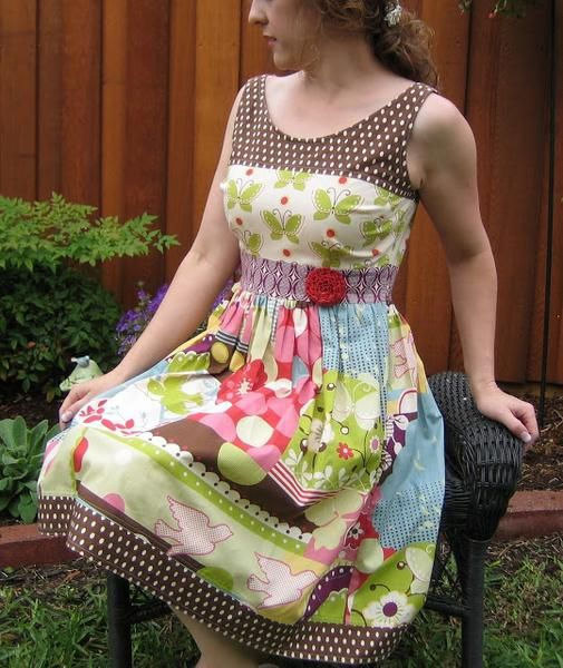 Paper sewing pattern to make a classic dress with the following features: flattering neckline raised waistline full A-line skirt solid or pieced bodice Conditio