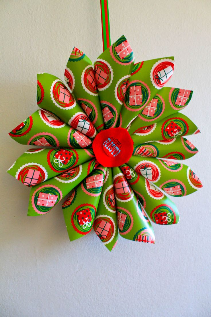 DIY.. Christistmas decorations... make cones staple them in the middle.. stick a felt round circle in the middle and done you have a beautiful wall decoration that should cost you less than $2