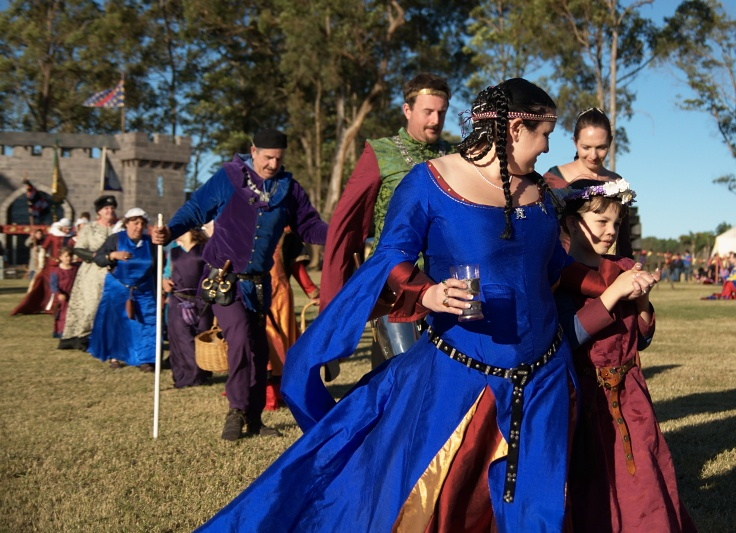 Don't think I have seen this shot before, but I love it, Abbey Medieval Festival family fun, even for the re-enactors, and gorgeous colour