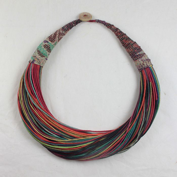 "Amanda Caines  ""creates unique hand stitched and bound fabric jewellery and icons using semi precious stones, wood, object d'art and tumbled glass."""