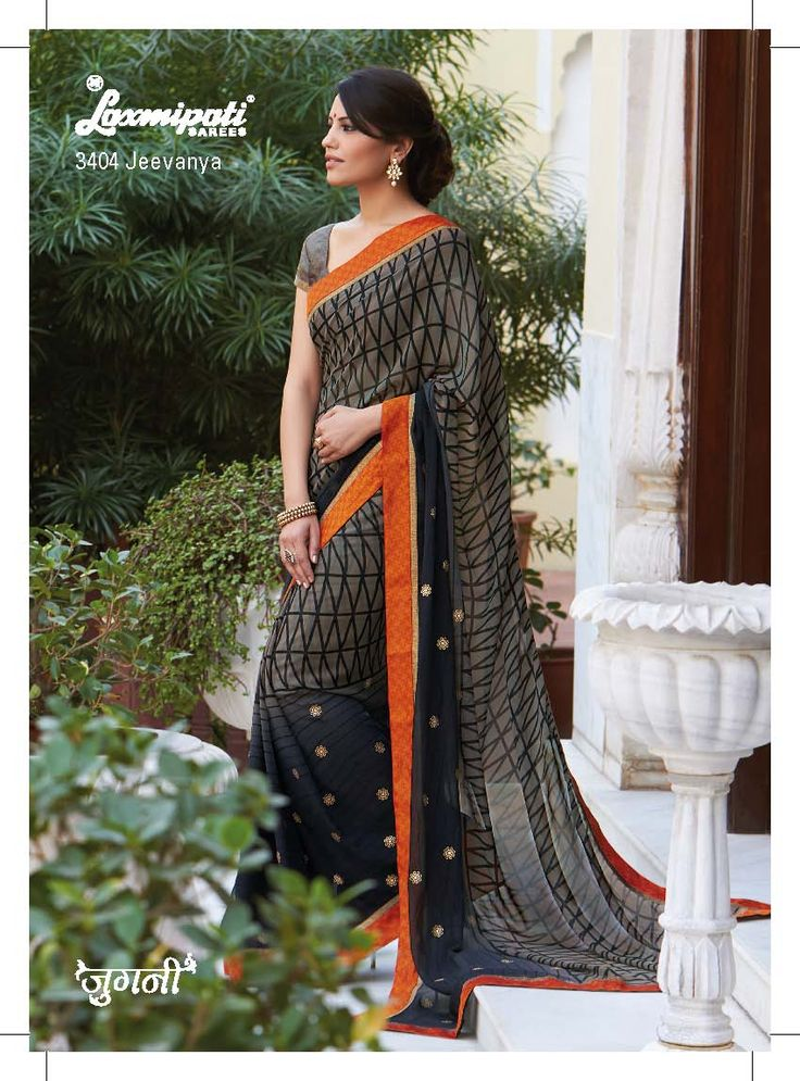 The attire is divided into half-half concept- the upper portion geometrical prints and on lower, line prints with sparkle work are given.