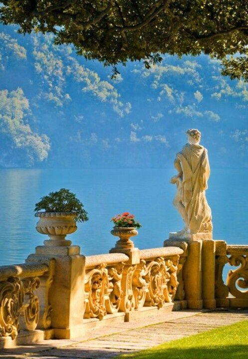 Scrolling stone fence with flower urns. Lake Como, Italy. Photographer John Scanlan.