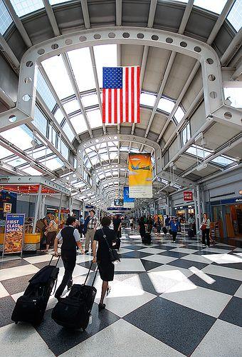 Two Flight Attendants Rushing Off thru Chicago OHare
