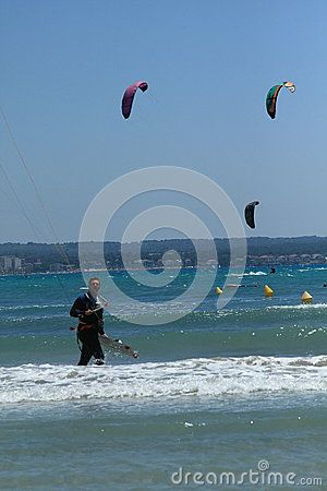 Kitesurfing on a sunny day in the Playa de Palma. Mallorca, Spain