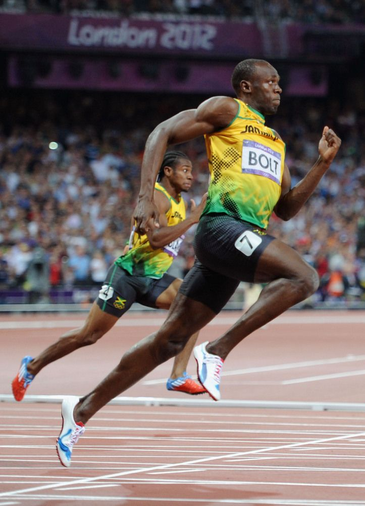 Usain Bolt of Jamaica leads Yohan Blake of Jamaica on his way to winning gold in the Men's 200m Final