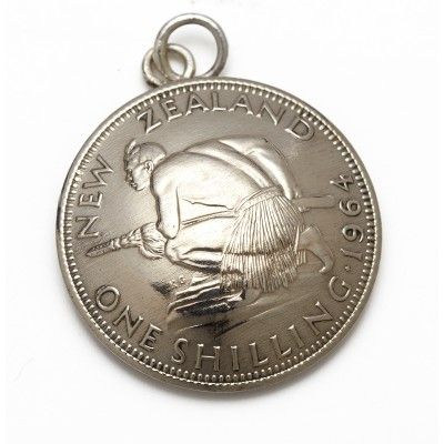 Vintage Coin Charm One Shilling. This one shilling vintage coin charm charm looks great added to silver charm bracelets or hung on a Stirling silver chain. It is hand crafted from vintage New Zealand currency no longer in circulation. The one shilling coin features a crouching Maori warrior on the front and Queen Elisabeth the Second on the back. Each coin is approximately 23mm in diameter. A great gift or souvenir genuinely Made in New Zealand.  See more at www.entirelynz.co.nz/gifts