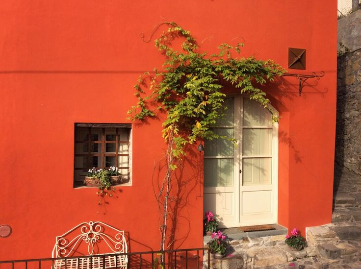 A brightly coloured village house in the historic centre