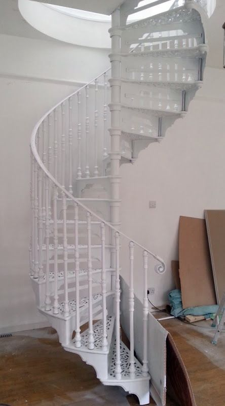 Excellent advice on painting cast iron spiral staircase, black to white. We have a similar style of stairs (in black) but I'd love them more if they were lighter colour like white!