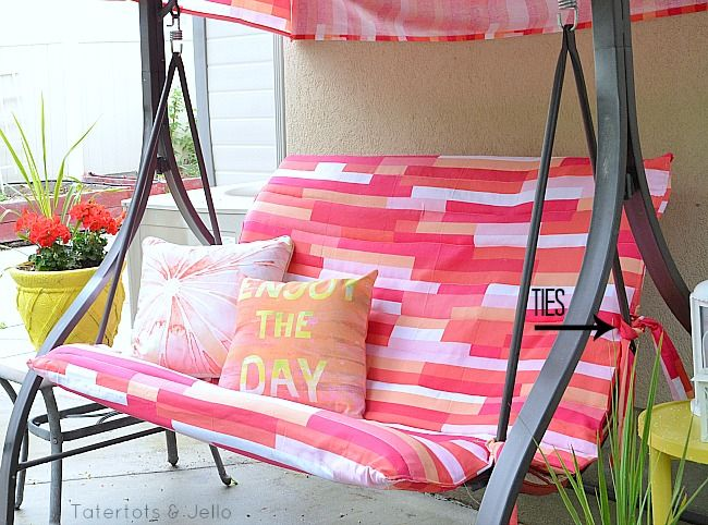 An outdoor swing makeover using shower curtains from Target. Great summer spruce up! #DIY #home #refashioning #sewing From tatertots & jello.