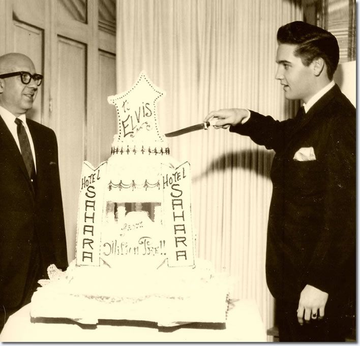 Elvis celebrates his twenty seventh birthday in Las Vegas with a cake supplied by the casinos owner and friend of Colonel Parkers, Milton Prell, January 8, 1962.