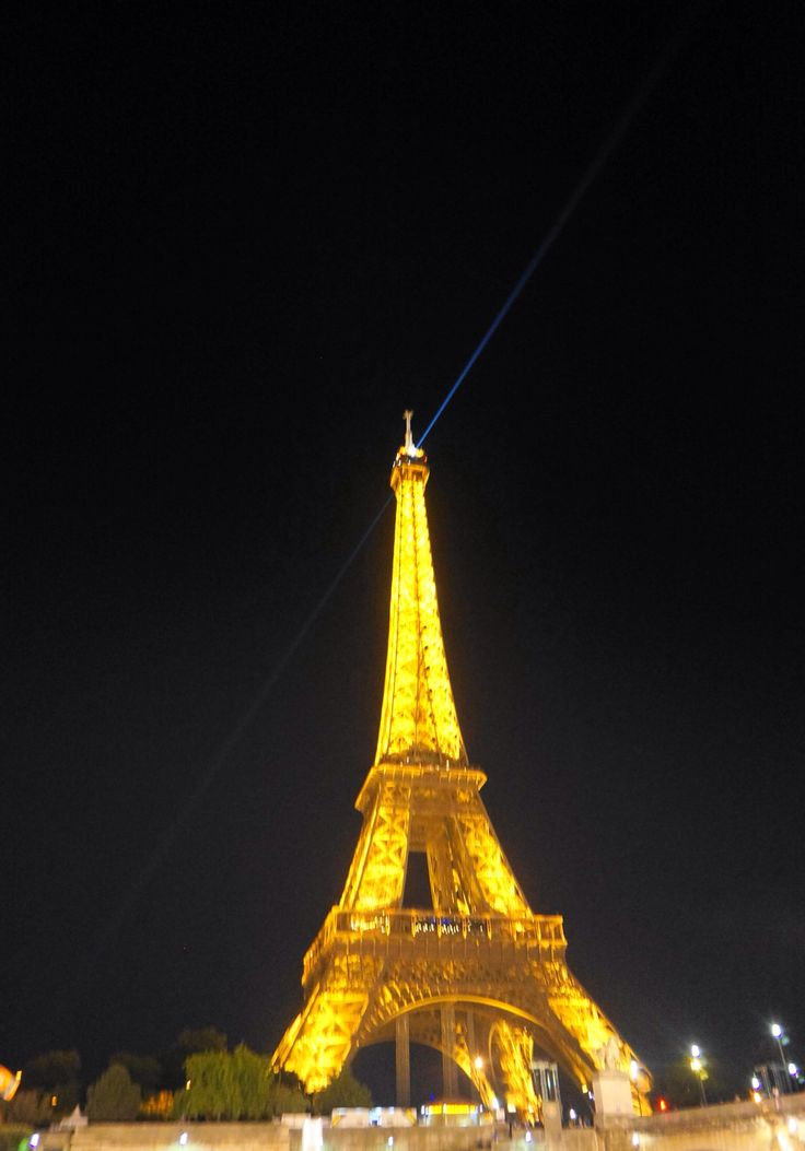 Eiffel Tower by night on a boat in the River Seine, Paris, France.