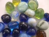 TBC CLEAR GLASS ASSORTED COLORS Decorative Gems: Vase Fillers, Table Scatters. Beautiful Unique Large Glass Stones. Size Aprox 1 Diam. Assorted Colors 100% Glass Gem Stones. Use in Floral Arrangements, with Candles, Aquariums, Wet or Dry. Great for Eye Ca