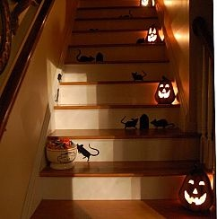 Having a Halloween party?  Stagger glowing pumpkins down the staircase to light the way.