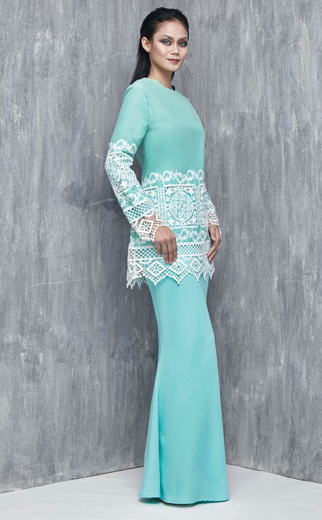 EMEL X SERENA C - LYRATA - Modern Baju Kurung with Lace (Green) This modern baju kurung is a statement piece for Raya. Features beautifuly embroidered and uneven detailing of lace on the bodice and sleeve with scattered matching coloured crystals. #emelxCLPTS #emelxSerenaC #emelbymelindalooi #bajuraya #bajukurung #emel2016 #raya2016 #SerenaC #lookbook #lace #crystals #green