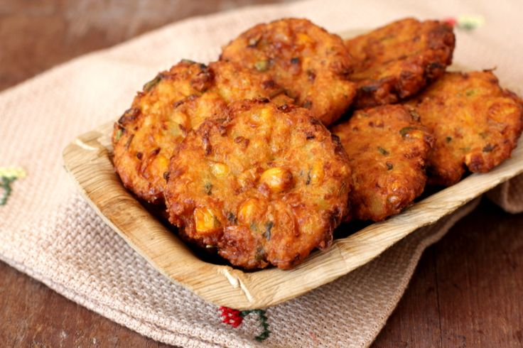 Corn Vada, a wonderful tea time snack prepared with few ingredients which include corn, bengal gram, onions, green chilies, ginger and coriander leaves.