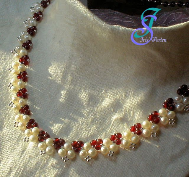 THIS IS ABSOLUTELY STUNNING!  WOULD BE LOVELY IN FW PEARLS AND GARNETS OR RUBIES!!