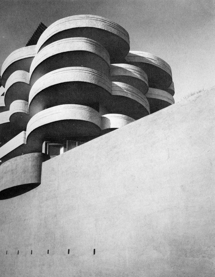 Apartment block, San Maurizio, Rome - 1962, by Luigi Moretti. Stunning. Like the Guggenheim's Italian cousin.