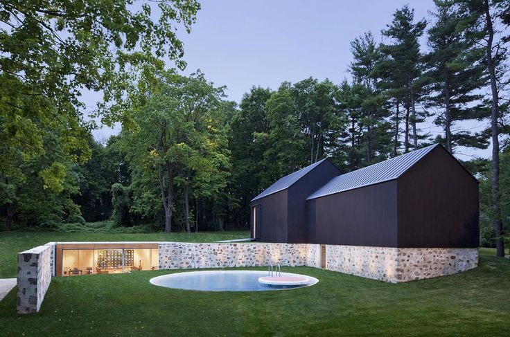 Robert C. Wiley House Additions - New Canaan, CT;  The art gallery, a reconstructed 19th century barn, offers a solid black contemporary counterpoint to original architect Philip Johnson's transparent house. The pool house (and a garage) are set into the hillside with a single exposed wall.  Designed by Roger Ferris + Partners;  photo by Paùl Rivera