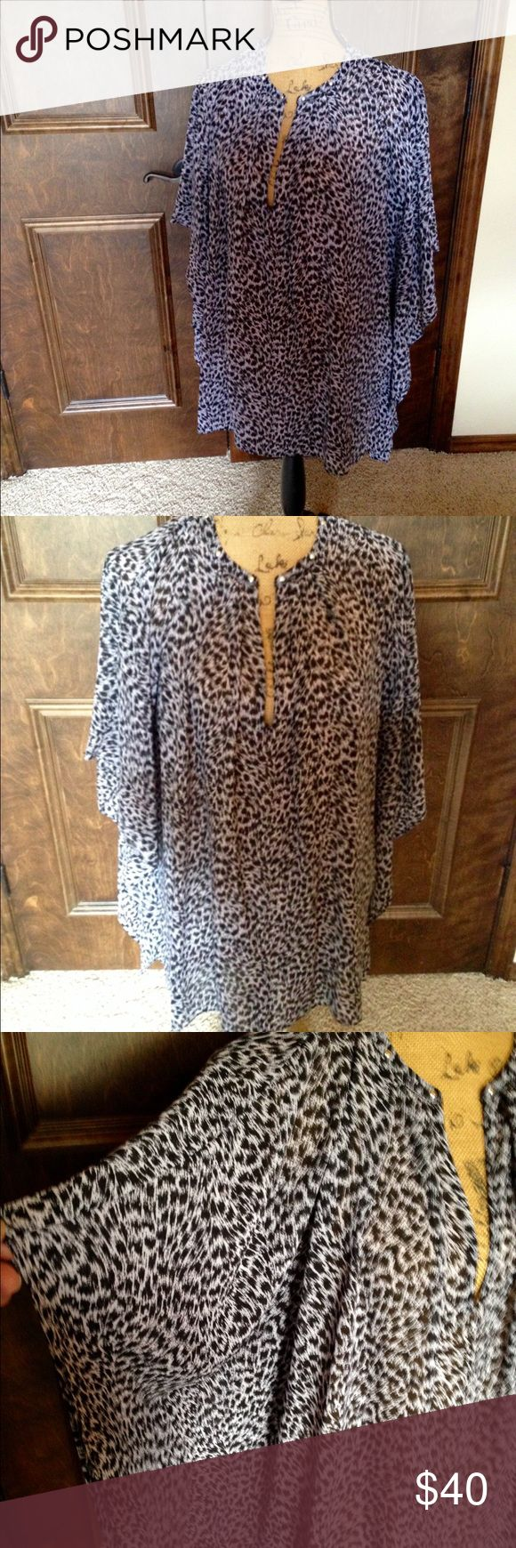 NWOT Michael Kors Batwing Top New without tags. Gorgeous black/white ocelot flowy top. Adorable batwing sleeve detail with silver embellishments at neckline. So flattering and forgiving!  Size XL. No Trades MICHAEL Michael Kors Tops Blouses