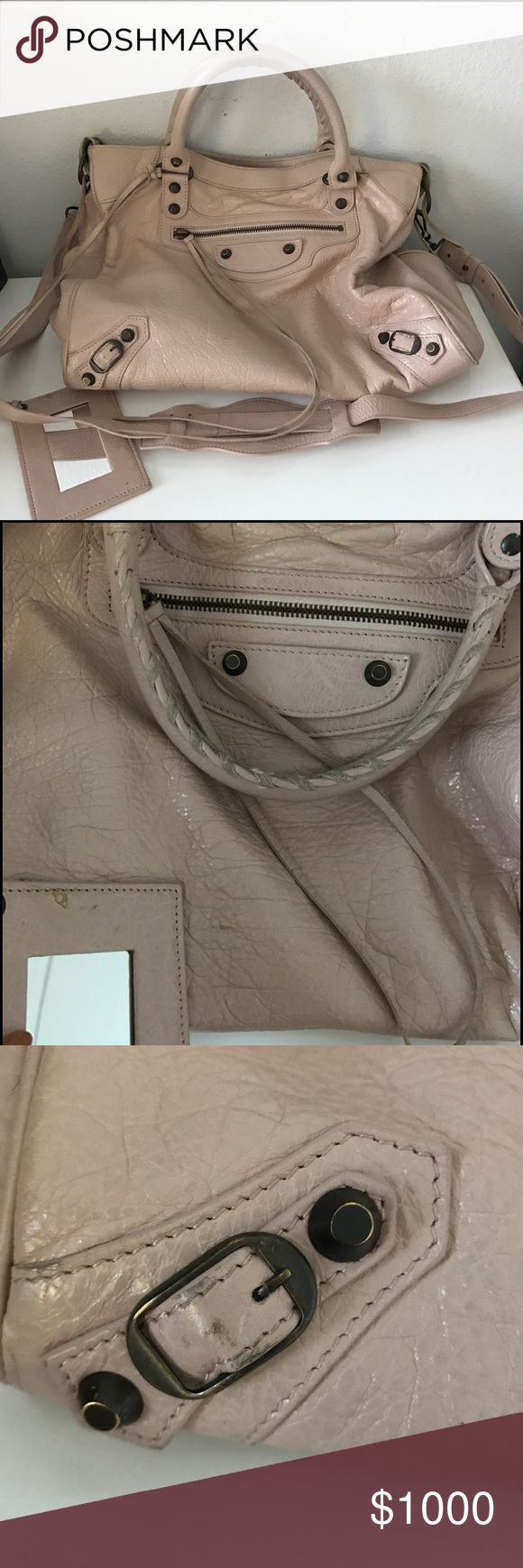 """Balenciaga Classic Velo Tote Lambskin Tote Bag Preowned Balenciaga Classic Velo Tote in Rose. Comes w tags from 2014. Normal wear w/fabric transfer from jeans. Soft lambskin crossbody w/nickel hardware, incl stud & buckle detail Rolled tote handles, 4.5"""" drop Removable shoulder strap, 19.3"""" drop Extended zip top closure Exterior zip pocket w/long tassel pull Removable leather-frame hand mirror Cotton-lined interior w/zip pocket, 2 open pockets & B embossed leather tag 10.5""""H x 13.3""""W x 6""""D…"""