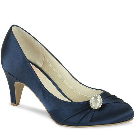 The Harmony closed toe navy shoes offer a supportive closed back, slightly round frontage and finished with a gorgeous brooch trim. These shoes are a great shoe for the bride wanting to wear a colour, bridesmaids or mother of the bride / groom looking to match an outfit. Also great for any occasion where a closed toe shoe with a low heel is needed.  Heel Height: 6cm