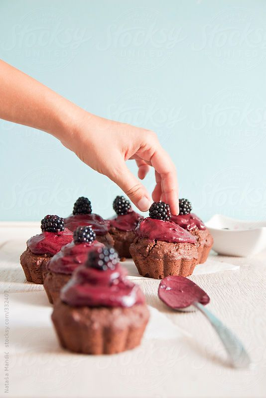 Chocolate Muffins with Blackberry Frosting via stocksy: Here is the recipe http://www.happygreenfood.com/muffin-di-cacao-e-cocco-con-crema-di-more/ #Muffins #Chocolate #Blackberry