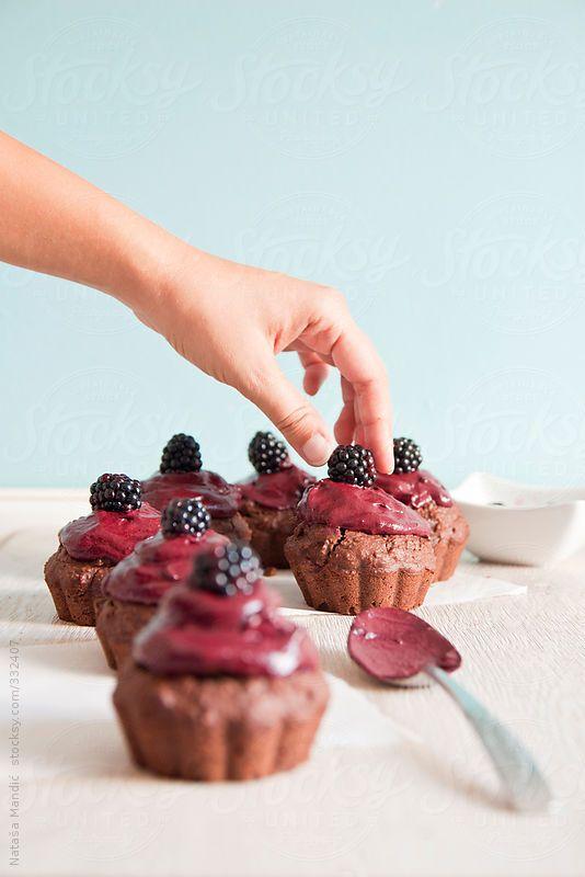 Chocolate Muffins with Blackberry Frosting via stocksy: Here is the recipe http://www.happygreenfood.com/muffin-di-cacao-e-cocco-con-crema-di-more/ #Muffins #Chocolate #Blackberry