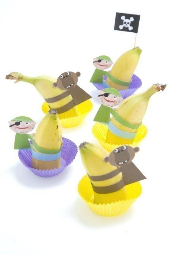 Pirate (& monkey) banana climbers - put in cupcake liner for cheap & healthy party fare.  PDF download.