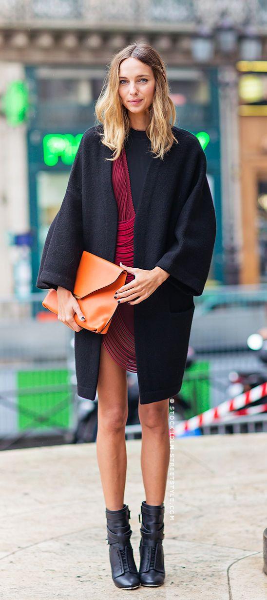 Candela, via Stockholm Street Style, is wearing a burgundy dress from Stella McCartney