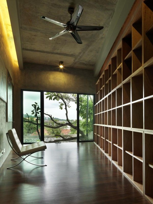 Study with recycled plywood shelves and FSC timber floor