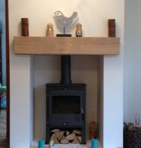 Fireplace sleeper mantel. I would stain it in a darker brown wood colour to ensure direct contrast vs. an off-white wall