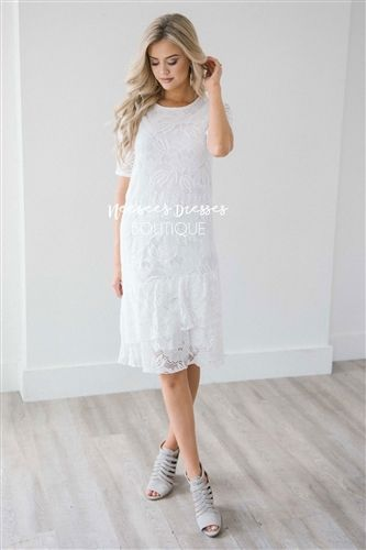 133400a69590 Who doesn't love an absolutely beautiful lace dress! This stunning white  floral lace dress features half sleeves and a tiered ruffle hemline.