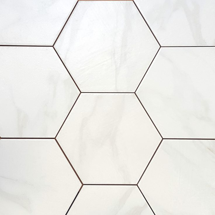 ATS Hex Carrara 9-1/2x11 | This beautiful Hexagon Porcelain Floor Tile with the look of Carrara Marble provides color consistency and durability not found in natural stone.