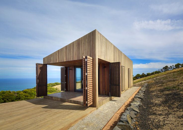 "Australian architects Jackson Clements Burrows added perforated shutters to the exterior of this holiday cabin ""like a Gore-Tex jacket"", providing light and ventilation when closed."