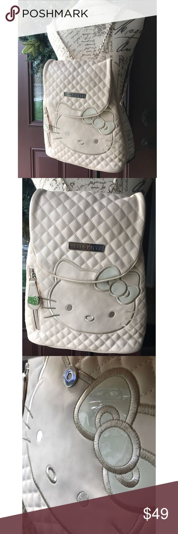 HELLO KITTY CREAM CHAIN STRAP BACKPACK New cream Hello Kitty chain strap backpack. With dustbag. Leather quilted . Patent leather hello kitty detail.  Silver chain strap. Side pocket. Pink signature lining. Hello Kitty Bags Backpacks