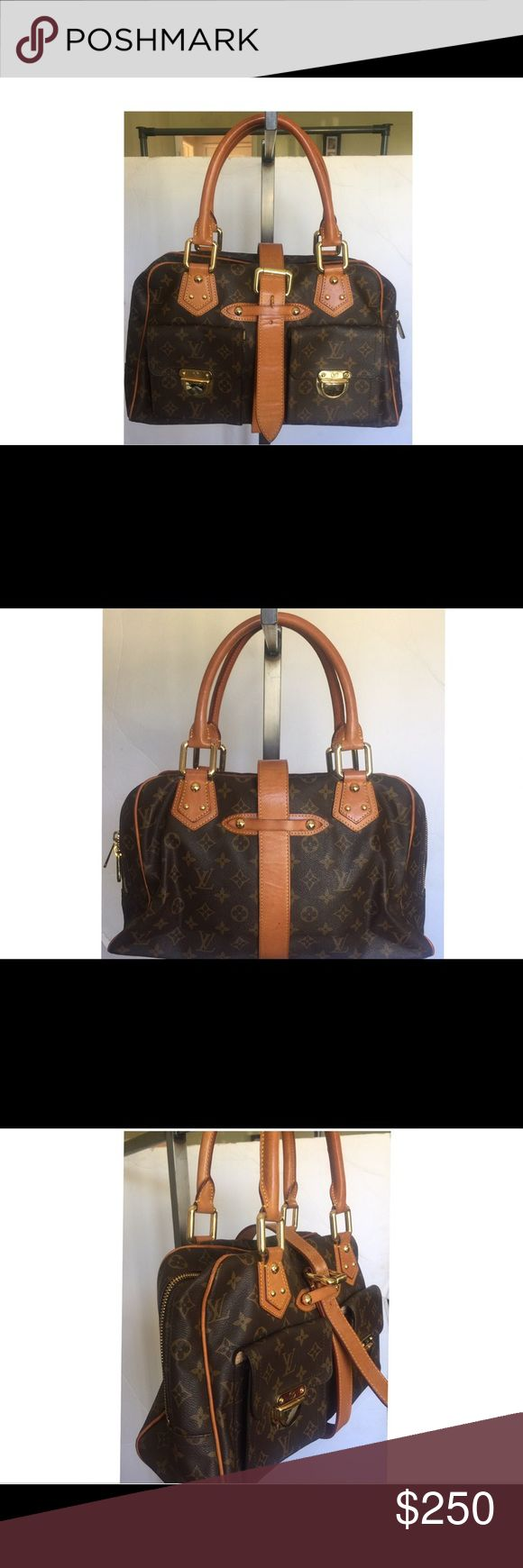 Louis Vuitton Manhattan Handbag Price is low because of the obvious so please don't ask. Good preowned condition, shows some signs of wear. Real leather heavy in weight and patina. Large size. Louis Vuitton Bags Satchels