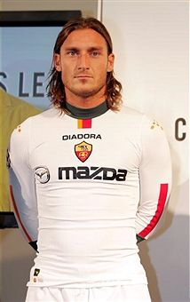 Captain of the Roma soccer team, Francesco Totti, appears on stage during a party to celebrate the Diadora & A.S. Roma launch of 'Champions League Shirt' at the Guggenheim Museum August 2, 2004 in New York City.