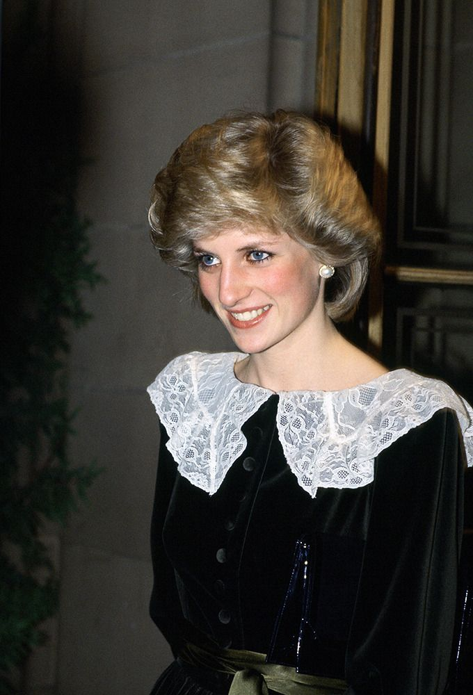 Princess Diana attends a Christmas concert, looking lovely in black with a white lace collar. via StyleList. 1981