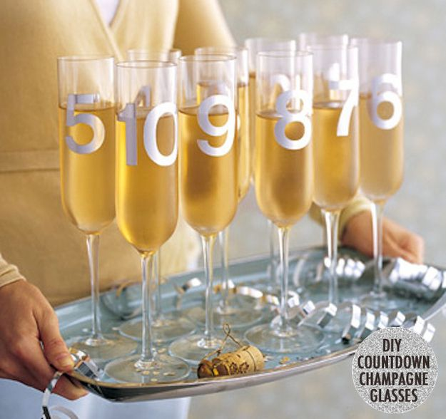 Make countdown champagne glasses by spray-painting numbers on them. | 51 DIY Ways To Throw The Best New Year's Party Ever