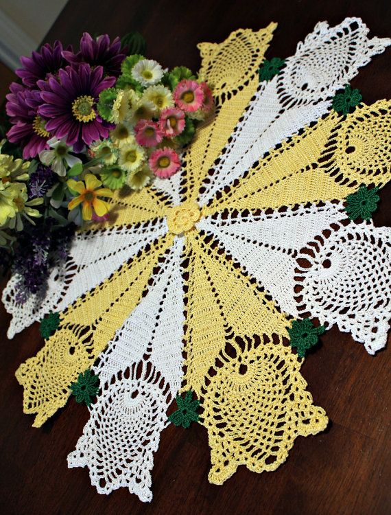 A charming handmade table topper made from white and yellow cotton thread #10. This elegant tulip design will look beautiful on any table or it will