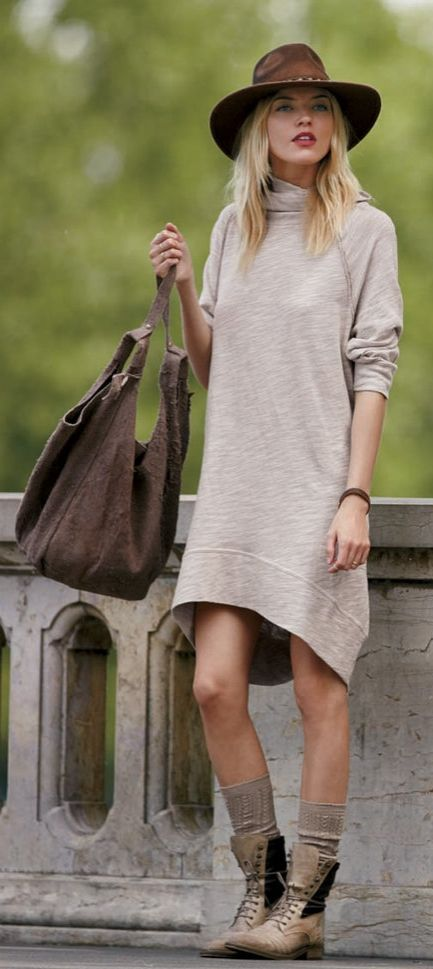 A slouchy sweater dress, combat boots, and a brown hat.