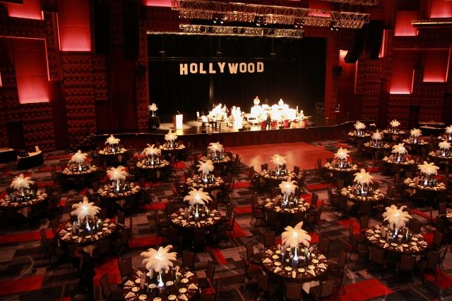 decorating for Gala at Harrahs casino - white feather centerpieces on black tablecloths! Really pops!