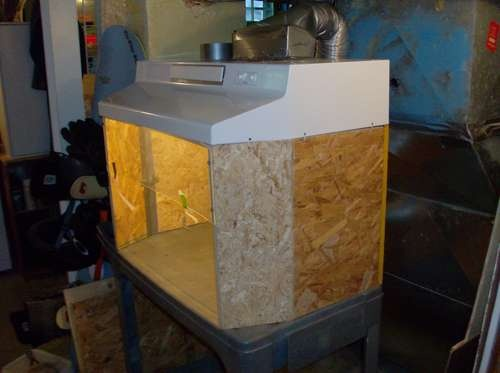 This fume hood might work for spray painting small projects, such as Games-Workshop miniatures.