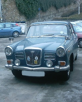 My Wolseley 16/60 many moons ago!  Pretty old, but a truly class act.  Only the Vanden Plas Princess R was better!