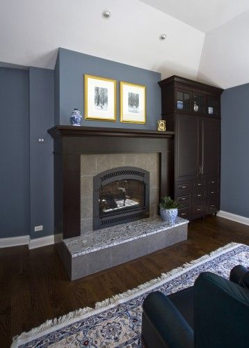 slate blue walls with dark brown wood and yellow accents... i need to remember this