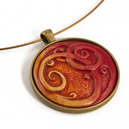 Ceramic Curled Red Koru Pendant by Craig Fletcher Angle